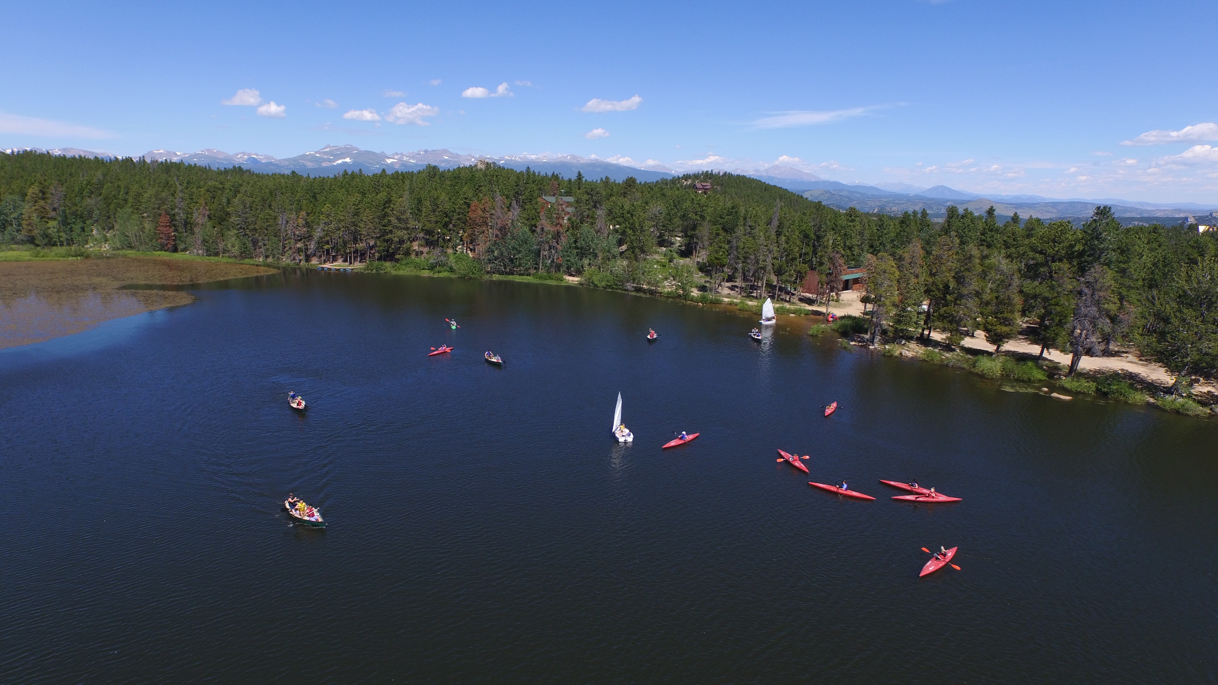 Image of Camp Granite Lake's beautiful lake and canoes